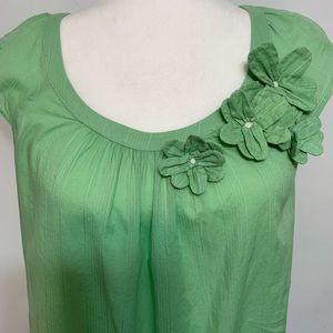 Ann Taylor LOFT cap sleeve top w/ flower appliqué.
